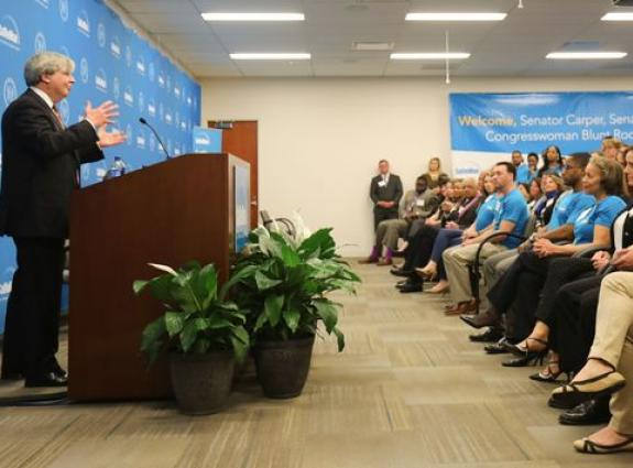Sallie Mae CEO Raymond Quinlan speaks to employees and state and local officials during a ribbon cutting for the company