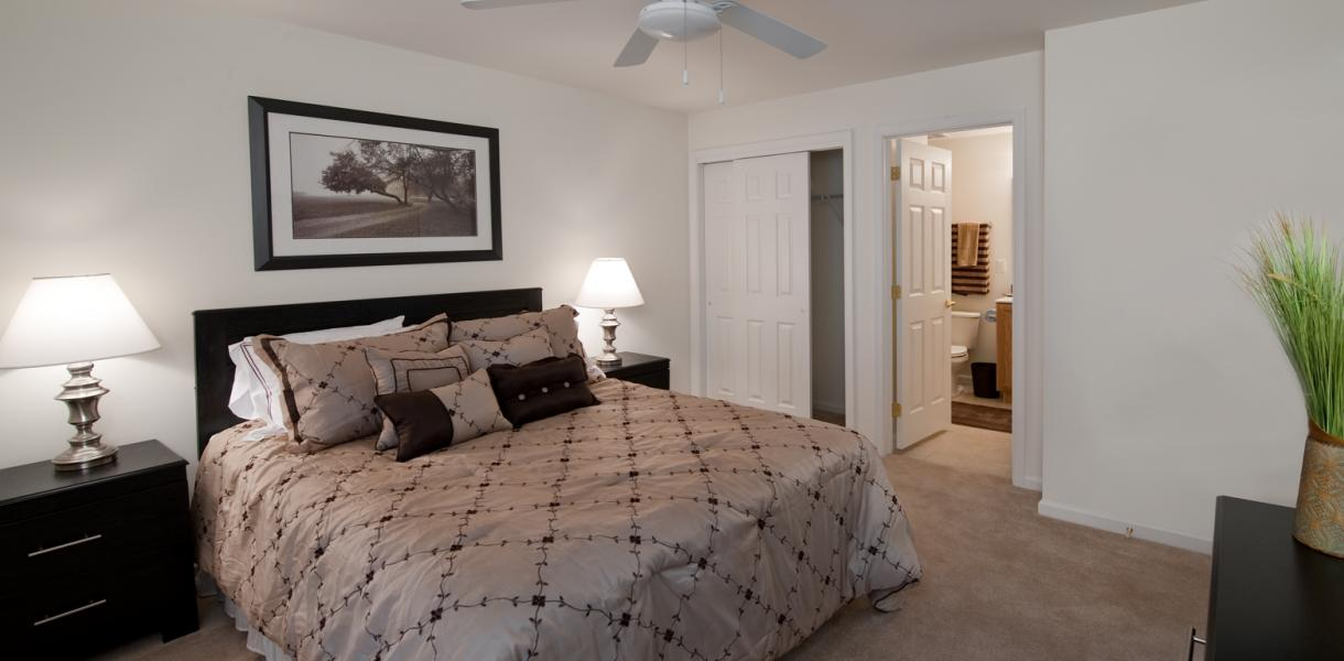 view of a bedroom within one of the apartments at Village at Blue Hen