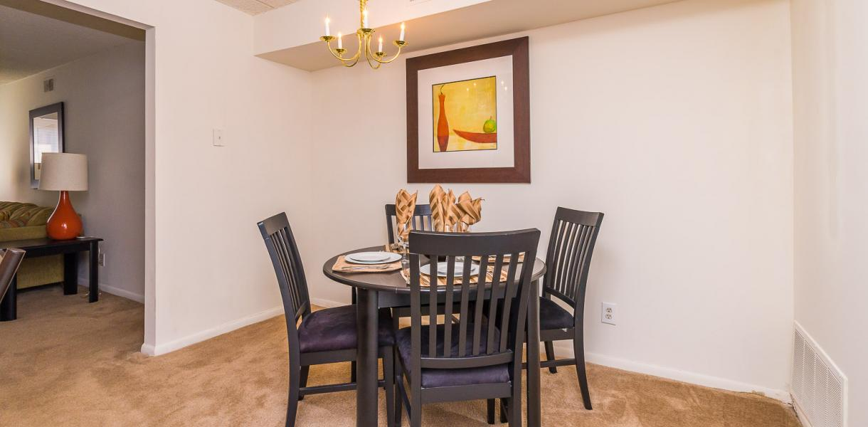view of the dining area at Salem Village Apartments with the living room off to the side