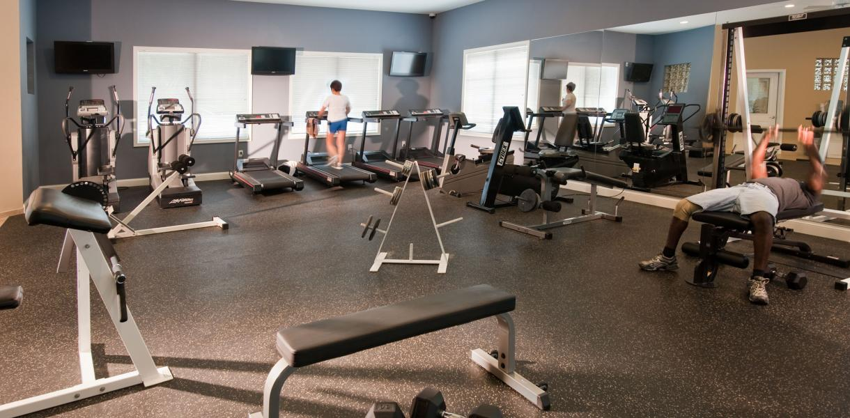 the fitness center at Greenville Place Apartments used by the residents
