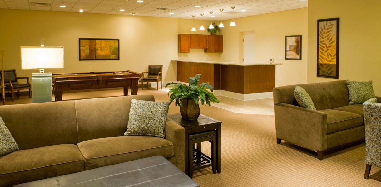view of a community center at the Towers of Greenville featuring a pool table and couches